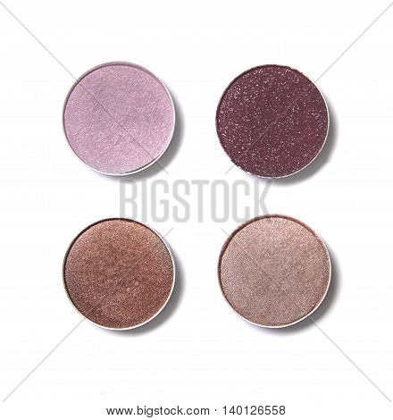 Neutral and pink toned eye shadow make up quad isolated on a white background