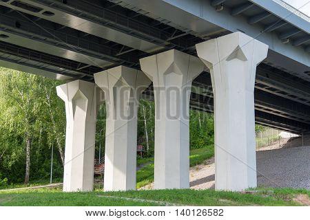 modern bridge columns on the green grass