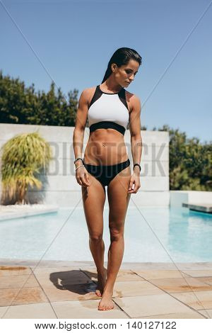 Fit Female Athlete After A Swim In Pool