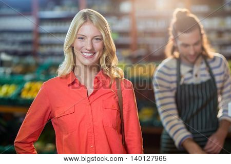 Portrait of smiling woman in supermarket