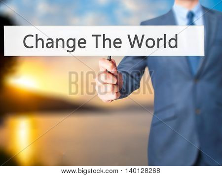 Change The World - Businessman Hand Holding Sign