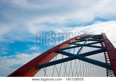 arch of red bridge with blue sky