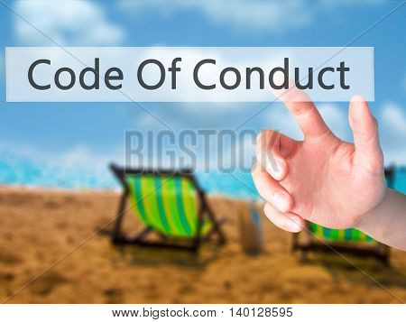Code Of Conduct - Hand Pressing A Button On Blurred Background Concept On Visual Screen.
