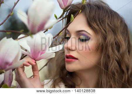 Close ip of beautiful spring girl with flowers