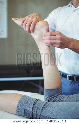 Woman receiving foot massage from physiotherapist in clinic