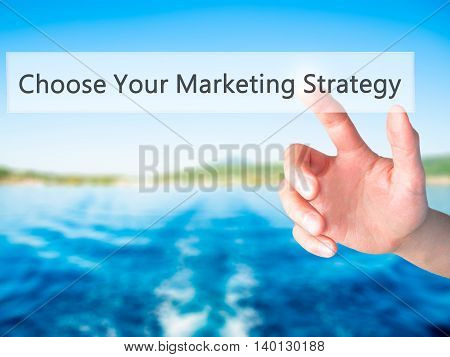 Choose Your Marketing Strategy - Hand Pressing A Button On Blurred Background Concept On Visual Scre