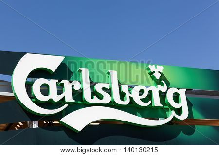 Lyon, France - July 3, 2016: Carlsberg logo on a wall. The Carlsberg Group is a Danish brewing company founded in 1847 by J. C. Jacobsen with headquarters located in Copenhagen, Denmark