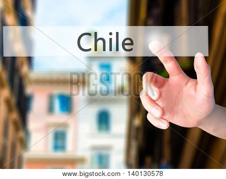 Chile - Hand Pressing A Button On Blurred Background Concept On Visual Screen.