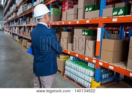 Business man is concentrating during his work in a warehouse