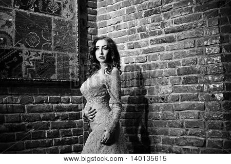 Fashionable Model Girl At Pink Evening Dress Background Brick Wall.