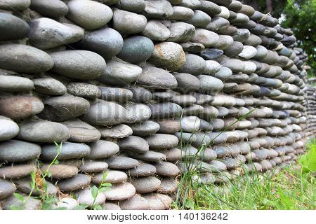 Stone fence with the grass in the Park
