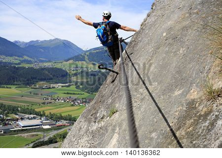 man shows to mountains on a wall