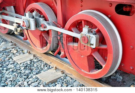 Detailed view of an old steam locomotive wheels of