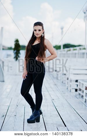 Young Girl At Black Clothes Posed On The Pier