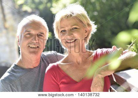 Portrait of senior couple in garden