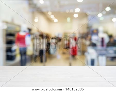 White wooden board empty table in front of blurred background. Perspective white wood over blur in shopping store - can be used for display or montage your products. Mockup for display of product.