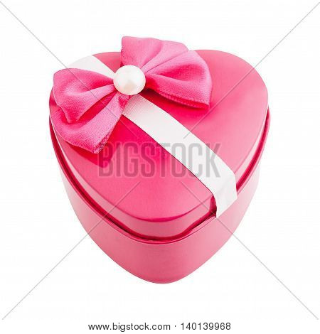 Metallic pink gift box shape heart with a bow isolated. Top view