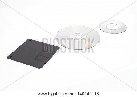 Black Floppy disk data storage and cd dvd on white background