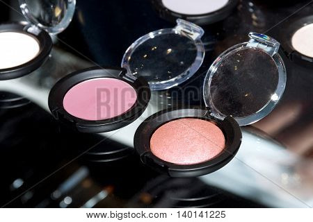 Colorful woman rouge. Perfect makeup. Cosmetic salon