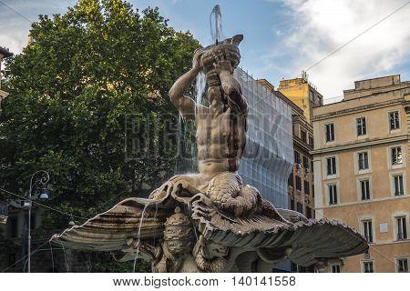 Rome, Italy. Triton Fountain at Barberini square. Fontana del Tritone at Piazza Barberini was sculpted by Bernini around 1642 AD.