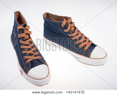 Sneakers made of denim on a white background
