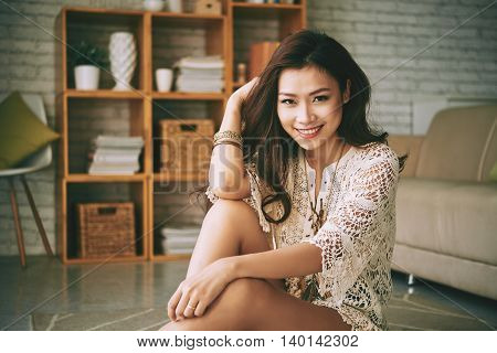 Portrait of charming Vietnamese girl at home