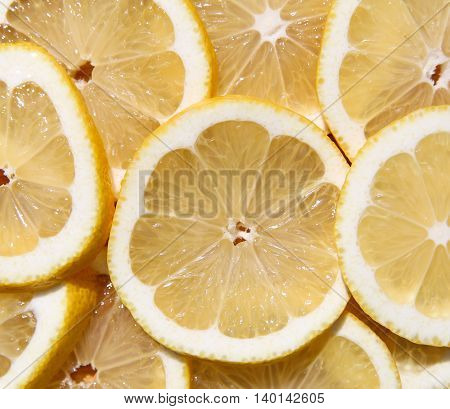 The lemon cut by circles. Top view. Background
