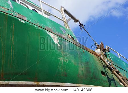 Close Up of Rusty Green Fishing Boat
