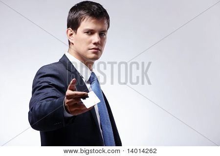 A Man Holds Out A Credit Card