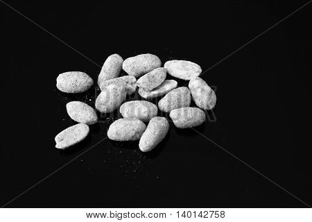 Black and white landscape orientation of dry roasted peanuts