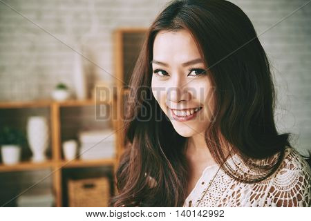 Face of attractive Vietnamese girl looking at camera
