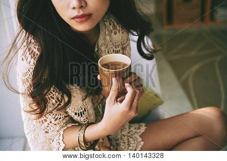 Beautiful woman drinking coffee in the morning