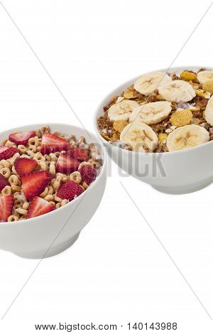 close up image of two bowl of cereal with different fruits