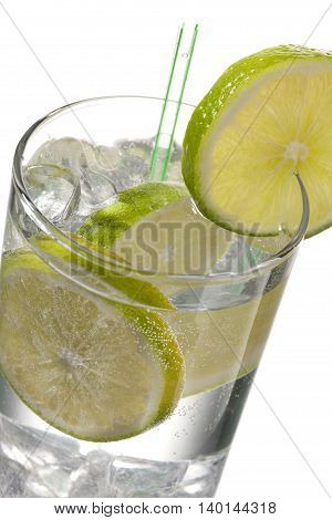 cold drink with lime isolated on white background