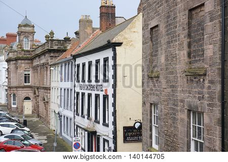BERWICK-UPON-TWEED, UK - JULY 20: Parked cars line a street of historic buildings in the centre of the northeast England town of Berwick-upon-Tweed, Northumberland on July 20, 2015.