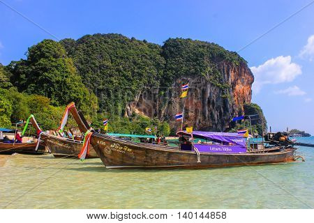 Poda island, Thailand, Asia - 30 December 2013: boats on the shore of the Andaman sea on the island of Poda