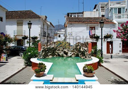 ESTEPONA, SPAIN - JULY 18, 2008 - Small square with a fountain just off the Calle Real Estepona Malaga Province Andalusia Spain Western Europe, July 18, 2008.
