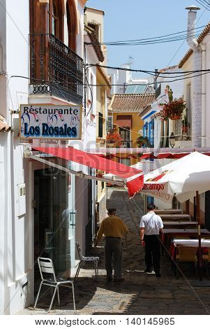 ESTEPONA, SPAIN - JULY 18, 2008 - Restaurants along a narrow side street in the old town Estepona Malaga Province Andalusia Spain Western Europe, July 18, 2008.