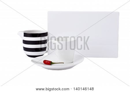 red chili in white plate with cups and white paper