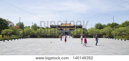 Hue, Vietnam - Jun 16, 2016: Visitors coming to see the Imperial Royal Palace of Nguyen dynasty at Ngo Mon gate. This gate is one of the forbidden city main gates leading to the central palace.