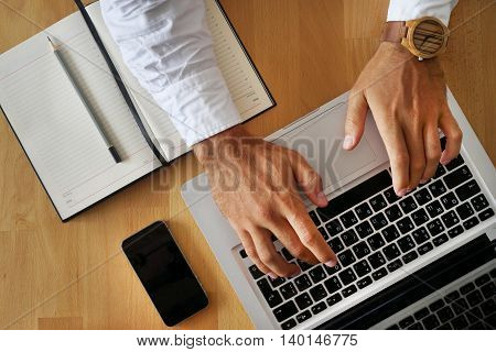 Man with his hands on the keyboard