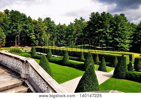 Lenox Massachusetts - September 16 2014: Trees clipped into cone shapes on the formal terraced lawns at The Mount Edith Wharton's Summer home *