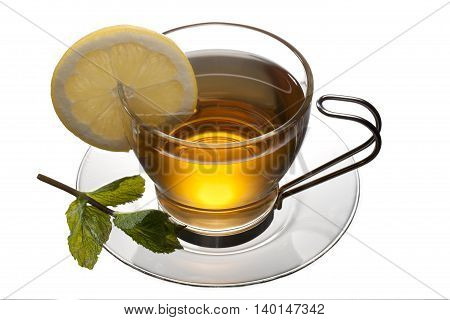 tea cup with lemon and leaves on a saucer