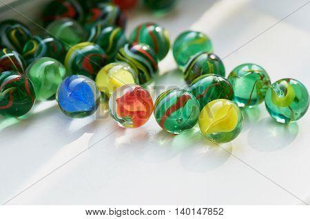 Bright glass multicolored glass stones round. Macro