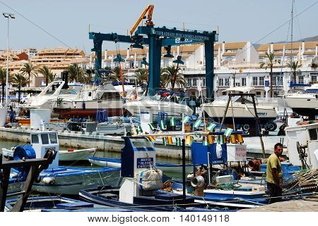 ESTEPONA, SPAIN - JULY 18, 2008 - Traditional Spanish fishing boats in the port Estepona Malaga Province Andalusia Spain Western Europe, July 18, 2016.