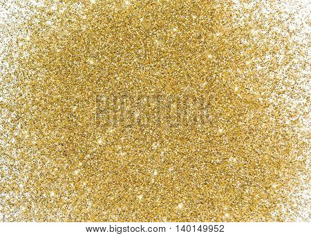 Gold sequins. Bright shine. Yellow powder. Shining background