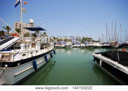 ESTEPONA, SPAIN - JULY 18, 2008 - Yachts and boats in the and the marina with waterfront buildings to the rear Estepona Malaga Province Andalusia Spain Western Europe, July 18, 2008.
