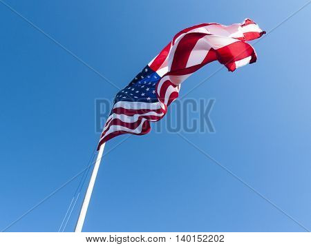 American flag twisted into complex curves by light wind