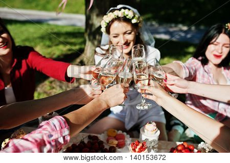Close Up Champagne Glasses On Hands Of Friends At Bachelorette Party