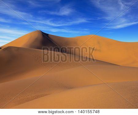 Orange sand dunes in Death Valley, California. Sunrise in Mesquite Flat